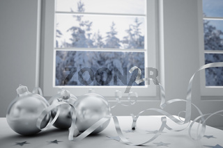 christmas balls on a background winter landscape in a window