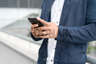 Close up Man texting on cell phone.