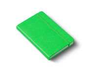 Green closed notebook isolated on white