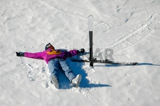 Female skier relaxing in the snow