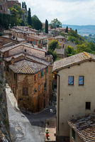 Houses and empty street at Montepulciano medieval hill town. Tuscany Italy, Europe
