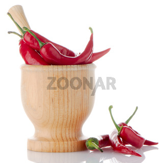 Red chili in wooden mortar
