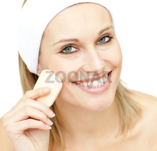 Cheerful woman putting foundation cream