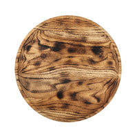 Round oak wood cutting board isolated on white