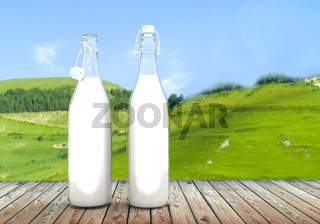 two bottle of milk on wooden table