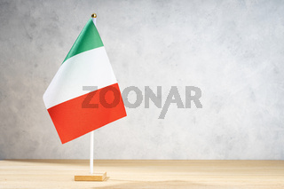 Italy table flag on white textured wall. Copy space for text, designs or drawings