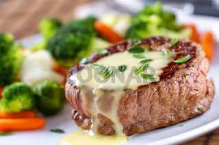Fillet of beef with bearnaise sauce. High quality photo.