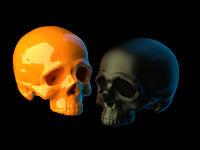 Abstract 2 sculpted orange and black plastic skulls without lower jaws isolated on black background. 3d illustration