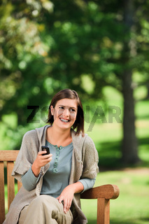Woman phoning on the bench