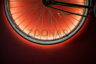 Close up shot of bicycle wheel illuminated