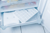 Ice cube maker in modern freezer with no-frost