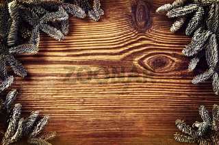 wooden board with sprunce branches