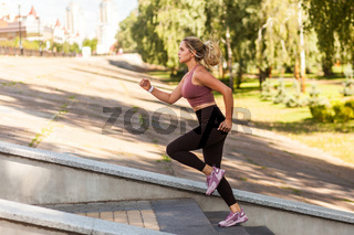 Outdoor sport of young woman in summertime.