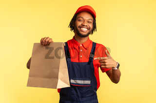 Workman in uniform pointing at ordered parcel, delivering food in paper package, post mail services.