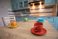 Tea cups on the table against the background of the kitchen.