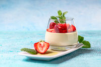 Vegetarian panna cotta with matcha tea and strawberries.