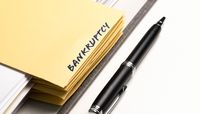 ring binder with word BANKRUPTCY written on binding divider