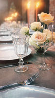 Amazing banquet table settings with floral arrangements for dinner party or wedding in restaurant