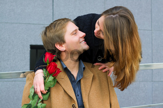 Happy young couple with a roses