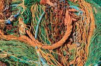 old fishing net with rope and chains