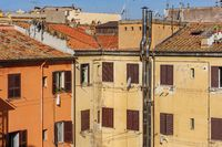 Typical view of usual old residential buildings with tile rooftops in Rome, Italy