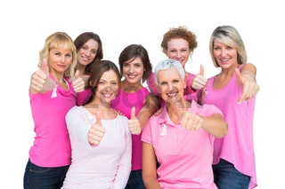 Positive women posing and wearing pink for breast cancer