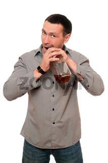 Man opens a bottle of whiskey. Isolated