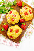 Scones with strawberry on board top