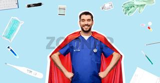 smiling doctor or male nurse in superhero cape