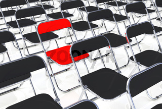 Der rote Klappstuhl in der Menge
