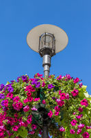 Street lamp with flower decoration in the city Meiningen