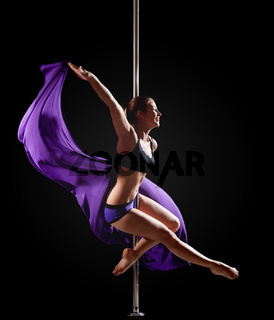 girl show gymnastic exercise with pole dance