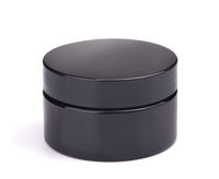 Black plastic cosmetic jar
