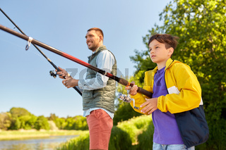 father and son fishing on river