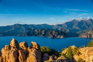 Panoramic view of the Gulf of Porto with rocks in the foreground, Corsica. Copy Space for characters or letters.