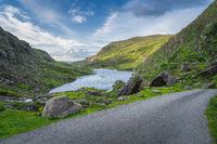 Beautiful landscape with lake, green hills and winding road in Gap of Dunloe, Black Valley