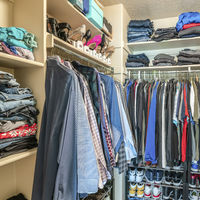 Square frame Small walk in closet with hanging rods and shelves