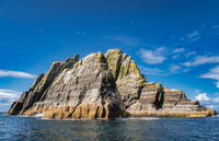 Rocky Little Skellig island with hundreds of Gannets flying around
