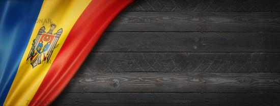 Moldova flag on black wood wall banner