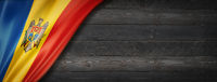 Moldova flag on black wood wall banner