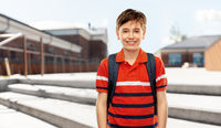 smiling student boy with backpack