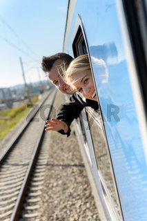 Woman man heads out the train window