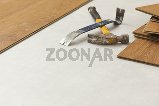 Hammer and Pry Bar with Laminate Flooring Abstract