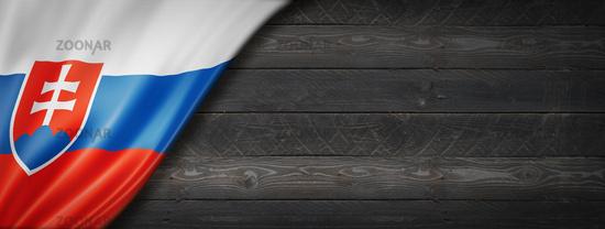 Slovakian flag on black wood wall banner