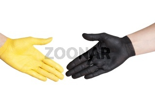 a yellow and a black hand giving hands