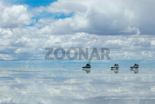 jeeps in the salt lake salar de uyuni, bolivia