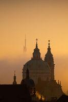 The Church of St.Nicholas in the mist. Prague, Czech Republic.