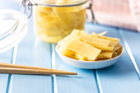 Sliced canned bamboo shoots in bowl.