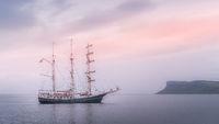 Beautiful tall ship anchored near Northern Ireland coast