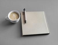 Booklet, coffee, pen